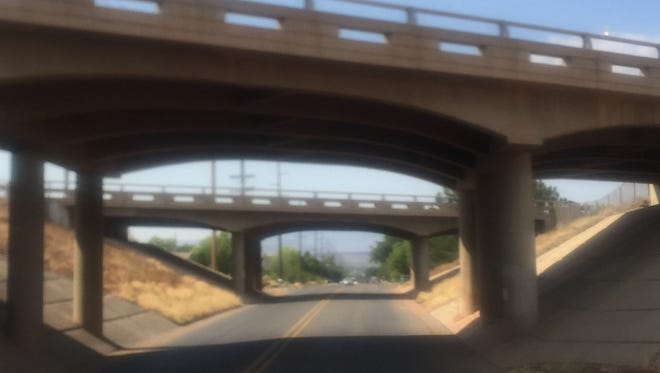 Interstate 15 crosses over Main Street in Washington City, where the homeowners in the largely residential area beyond are fighting to prevent the possibility of a new freeway interchange being built.