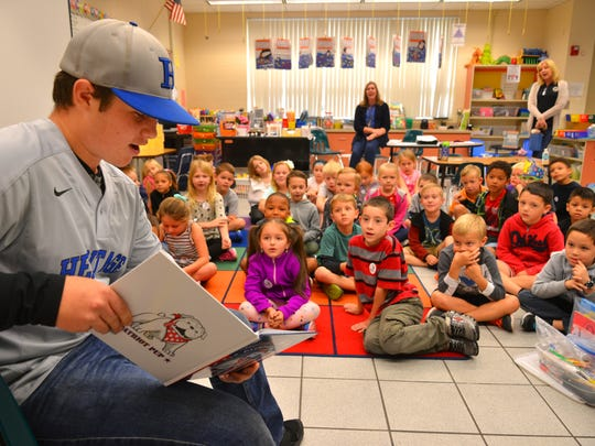 Heritage High School catcher Bryce Tyrner reads to