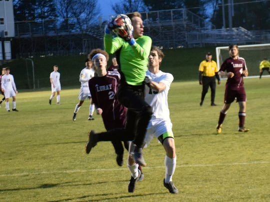 Luray goal keeper Brayden Burrill makes a save in front