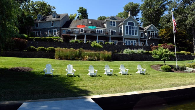 The view of the home from the lake. This lake-front home is selling for $2.2 million dollars in Hopatcong, NJ.
