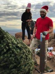 Jennifer Shively and Joel Borch put a Christmas tree