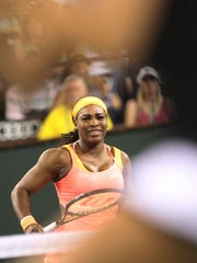 Serena Williams reacts on a bad return to Monica Niculescu during the 2015 BNP Paribas Open in Indian Wells. Williams won in two straight sets on March 13, 2015.