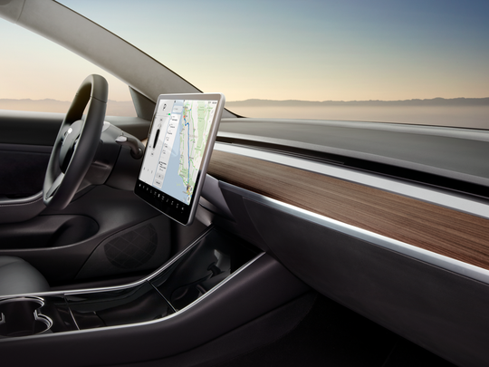 The Tesla Model 3's infotainment screen replaces analogy buttons with digital controls.