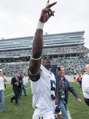 Michigan safety Jabrill Peppers celebrates as he walks off the field after the game.