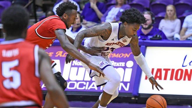 Northwestern State's Zeek Woodley drives against the Lamar defense on Wednesday night.