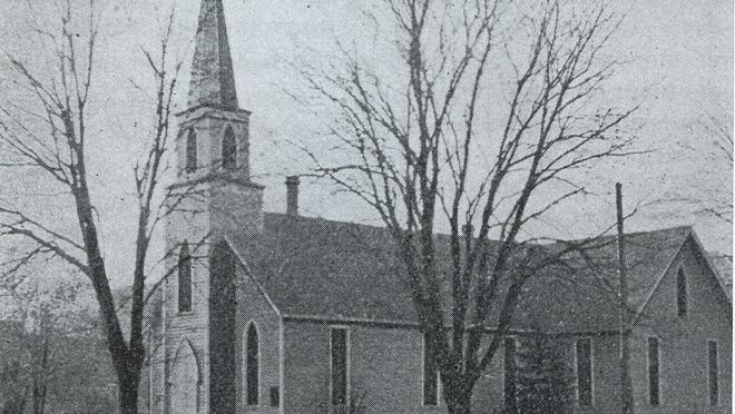 The first St. Paul's Episcopal Church is seen at Chemeketa and Church streets NE. The church was moved along Chemeketa in the early 1920s.