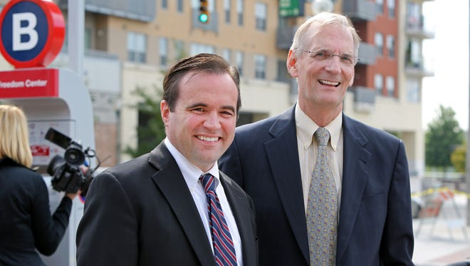 Mayor John Cranley (left) and Dr. Richard Lofgren, CEO of UC Health, were all smiles following the grand opening of Red Bike, Cincinnati's first bike sharing program.