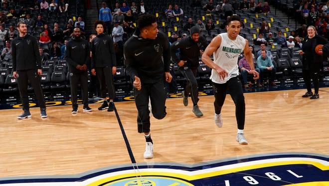 Bucks guard Malcolm Brogdon (in white jersey) joined Giannis Antetokounmpo and his other teammates on their trip west and ran sprints as part of his rehabilitation.