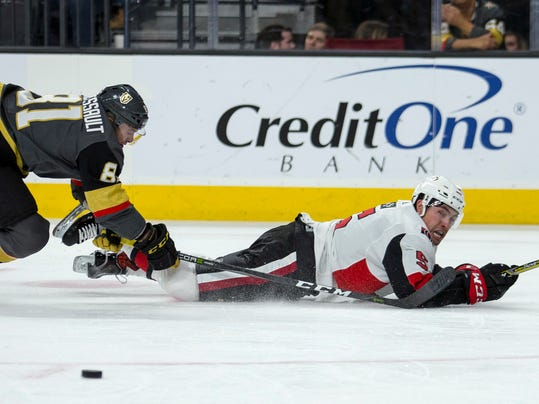 Ottawa Senators defenseman Cody Ceci (5) looks to the puck as Vegas Golden Knights center Jonathan Marchessault (81) tumbles behind him during the second period of an NHL hockey game Friday, March 2, 2018, in Las Vegas. (AP Photo/L.E. Baskow)