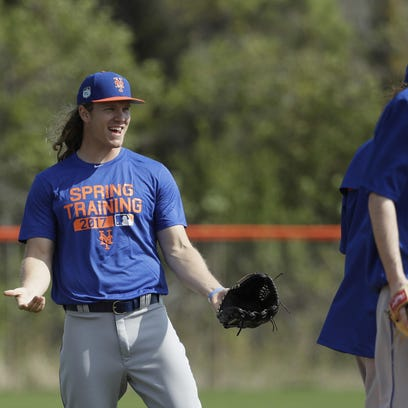 New York Mets starting pitcher Noah Syndergaard waits