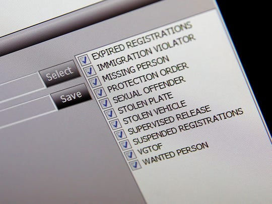 The reasons that a license plate read by an automated reader will be flagged is shown on a dispatchers screen at the Ocean County 911 Communications center in Toms River Friday, April 14, 2017.