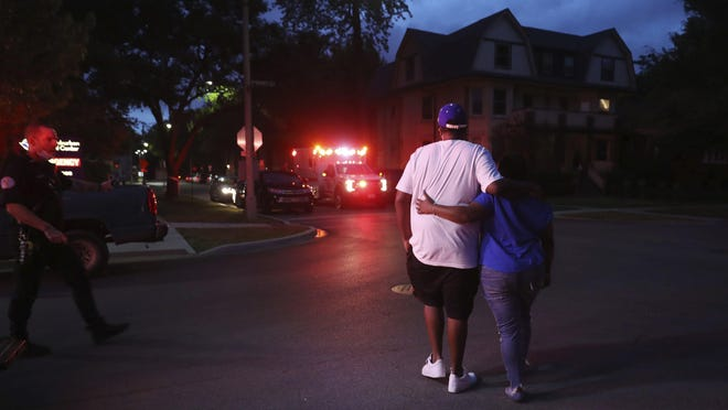Two people walk away from West Suburban Medical Center in Oak Park near Chicago, where a 3-year-old boy died after being shot while riding in an SUV with his father a few blocks away in Chicago's Austin neighborhood, Saturday, June 20, 2020. Multiple people, including several children, were killed as more than 100 people were shot in a wave of gunfire in Chicago over the Father's Day weekend.