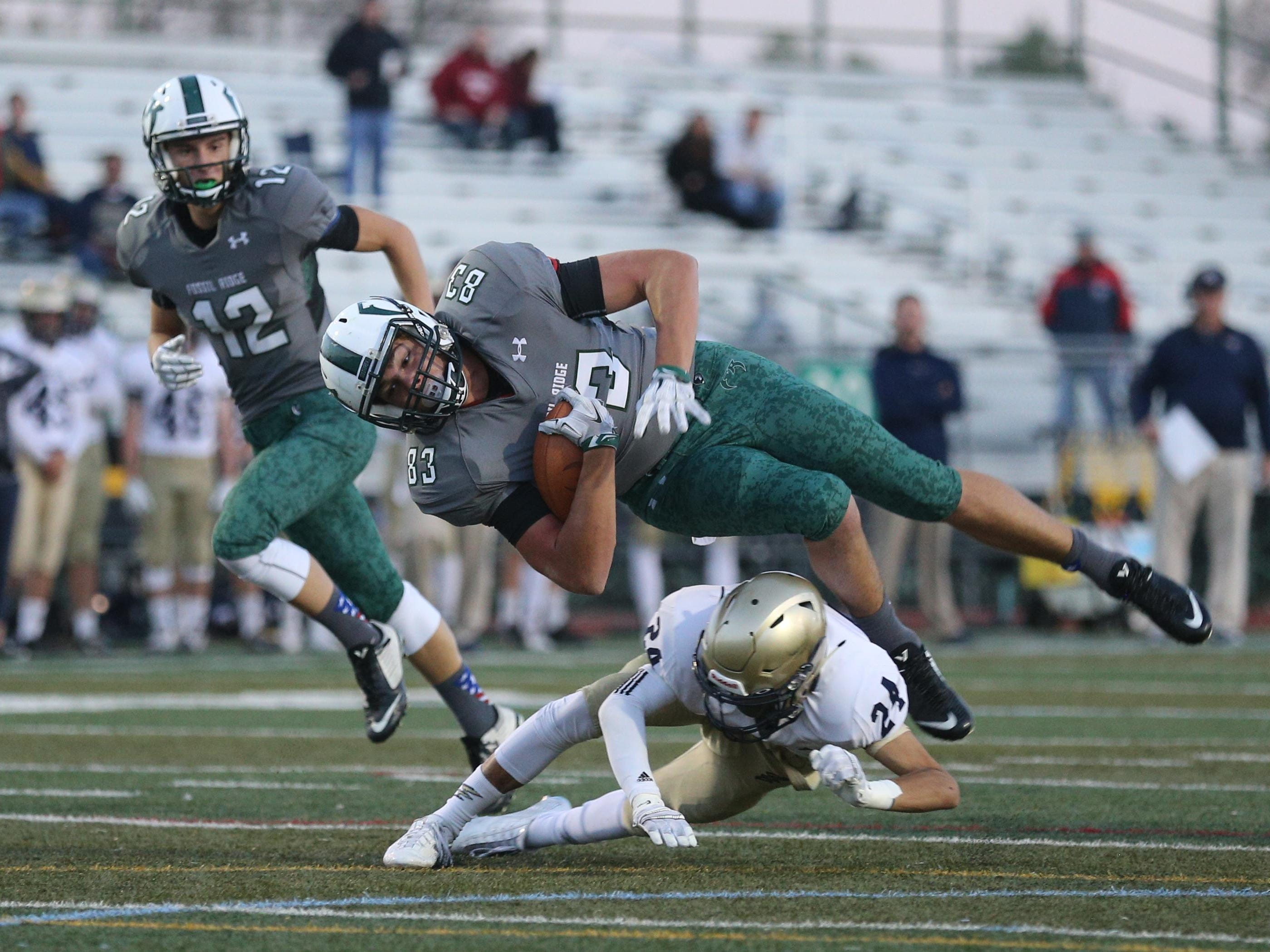 Fossil Ridge High School's Owen Arkin (Jr) gets tackled by Legacy High School's Devin Morlaes (Jr) during the first quarter at French Field in Fort Collins Colo. on Oct. 15, 2015.