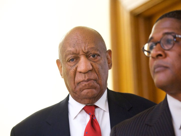 Actor and comedian Bill Cosby reacts while being notified