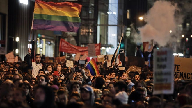 Protesters demonstrate on Fifth Avenue outside Trump Tower in Manhattan on Wednesday in opposition of Donald Trump's presidential election victory.