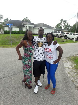 Dewayne Johnson poses for a photo with his grandmother (left) and mother Ebony Battles (right) on the Fourth of July. The photo was one of the last taken of the 24-year-old, who was killed a few hours later in Fort Myers.