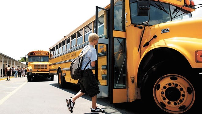 Students board school buses to be transported to Murray Middle School in 2017.