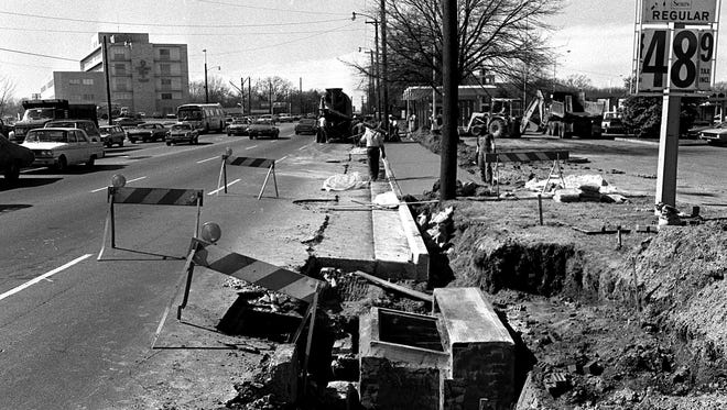 February 28, 1975 - Curb and gutter work is being completed as Poplar Avenue is widened west of Perkins Extended on Feb. 28, 1975. This photograph, looking to the west near Perkins Extended, indicates that Sears, Roebuck and Company is selling regular gasoline for 48.9 cents per gallon.
