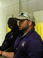 Aaron Lamb talks with coaches during the team's Week 2 game against Western Albemarle.