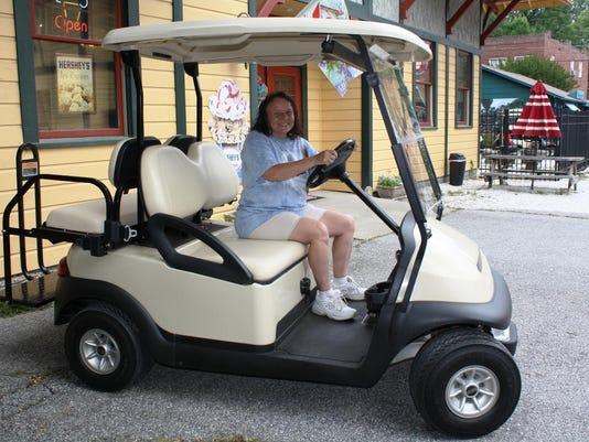 Lisa Bishop on Golf Cart