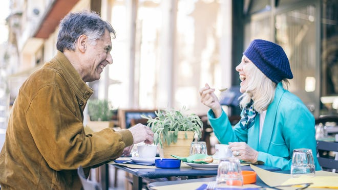 Older man and woman dining out