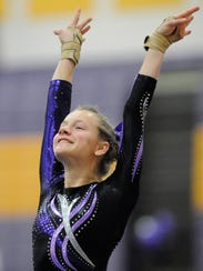 Mady Brinkman of Melrose finishes her floor routine