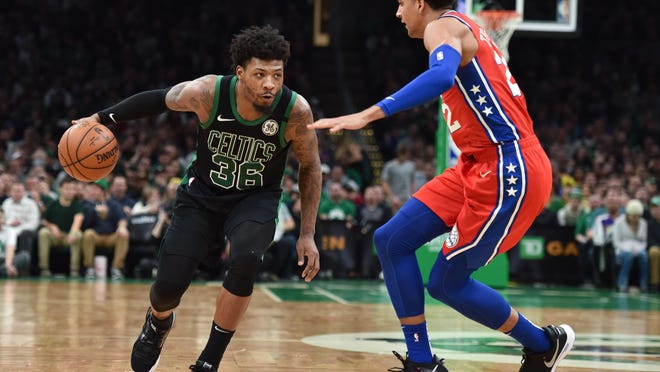 Celtics guard Marcus Smart tries to drive past 76ers guard Matisse Thybulle during a game on Feb. 1.  The two teams will meet for the 21st time in the playoffs beginning on Monday night.