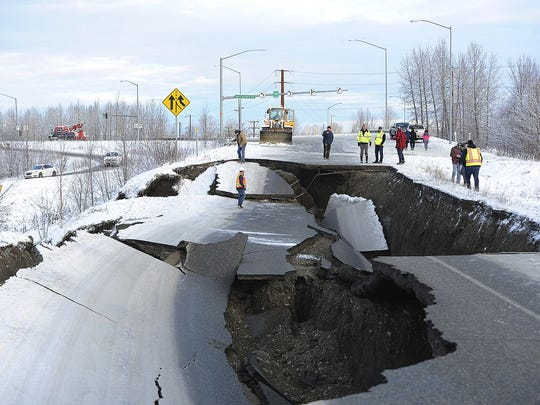 In this Nov. 30, 2018, file photo, workers inspect an off-ramp that collapsed during a morning earthquake in Anchorage, Alaska.