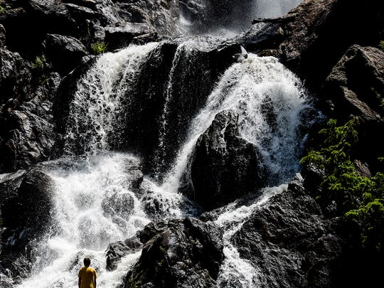 People enjoy the day at Fish Creek Falls Monday, July 13, 2015, near Steamboat Springs, CO.