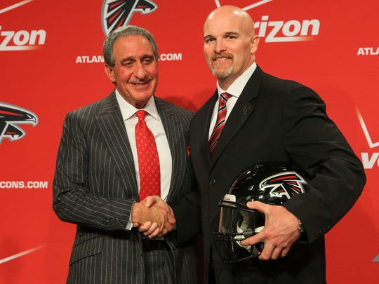 FLOWERY BRANCH, GA - FEBRUARY 03: Atlanta Falcons owner, Arthur Blank (L) poses with new head coach, Dan Quinn, during a press conference at the Atlanta Falcons Training Facility on February 3, 2015 in Flowery Branch, Georgia.  (Photo by Daniel Shirey/Getty Images)