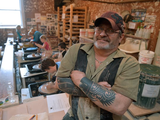 Dino Pfaff teaches an introductory pottery class for