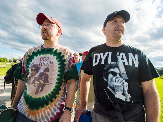 Bob Dylan fans Lyndon Johnson of Ticonderoga, New York, left, and George Hurlburt of Painted Poste, New York, wait for the doors to open before the idiosyncratic troubadour's concert at the Shelburne Museum on Tuesday, June 20, 2017.
