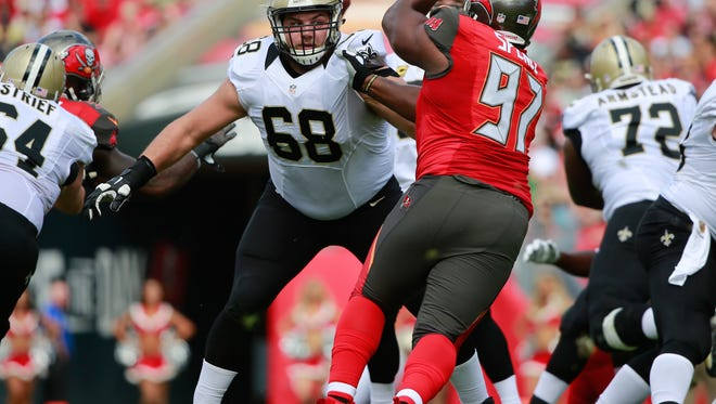 Dec 13, 2015; Tampa, FL, USA; New Orleans Saints offensive guard Tim Lelito (68) blocks Tampa Bay Buccaneers defensive tackle Akeem Spence (97) during the first half at Raymond James Stadium. Mandatory Credit: Kim Klement-USA TODAY Sports