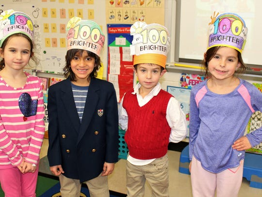 Kindergartners (L-R) Zoe Fahs, Krish Dave, Owen Zambell, and Hayden Montgomery celebrate 100 days at Central School in Warren on Feb. 14.