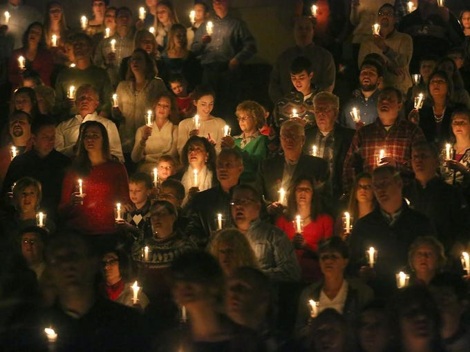 Christians worship during a Christmas eve service at