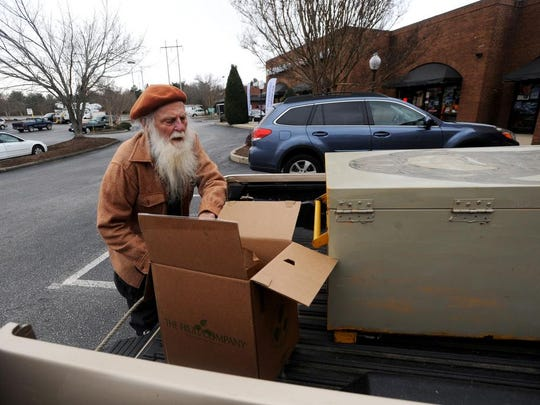 Asheville resident Bill Thurman, 83, loads boxes into his 2001 Toyota Tacoma near Fairview Road in East Asheville Jan. 7.