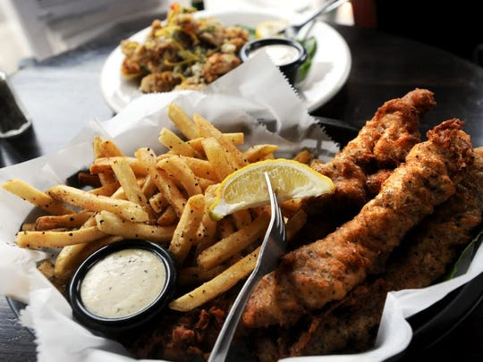 A basket of fish and chips served with a fresh lemon at the Oysterhouse Brewing Co. at 625 Haywood Road on Friday.