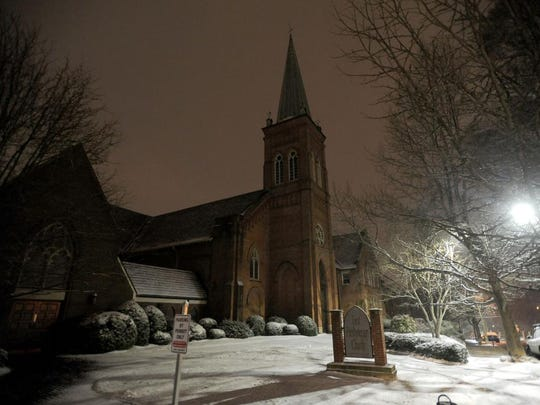 The First Presbyterian Church collects snow along Church Street in downtown Asheville Wednesday.
