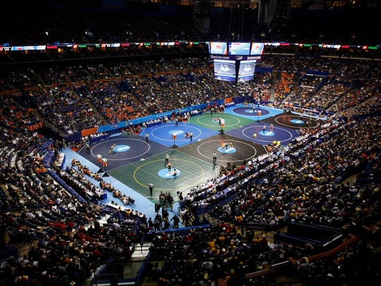 Fans pack Scottrade Center to watch first-round matches during the NCAA Division I Wrestling Championships Thursday, March 19, 2015, in St. Louis. (AP Photo/Jeff Roberson)