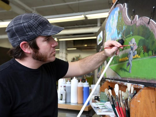 Jonathan Queen of Anderson paints a scene of Ault Park in his studio at Essex Studios.