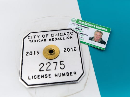 Taxi medallion values are plummeting in big U.S. cities
