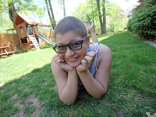 Adell Cirrincione,16, was diagnosed with Ewing Sarcoma, a rare type of bone cancer when she was 15. Cirrincione who is now in remission was photographed at her home in Congers May 8, 2015.