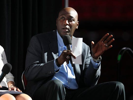 Robbie Valentine speaks to students at the KFC Yum Center during JCPS signing day in 2015.