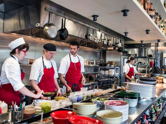 Patrick O'Cain, center, talks with his kitchen crew before the dinner rush at Gan Shan Station in North Asheville, Thursday, June 18, 2015.
