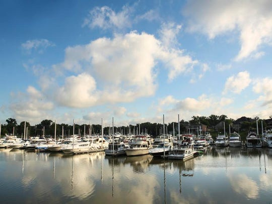 Boats sit on a peaceful morning at the Captain's Quarters