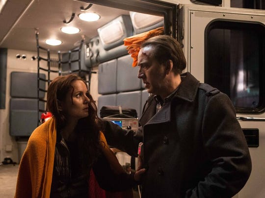 """Sarah Wayne Callies and Nicholas Cage in """"Pay the Ghost."""""""