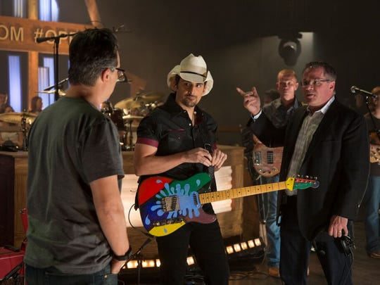 Brad Paisley talks with Opry general manager Pete Fisher