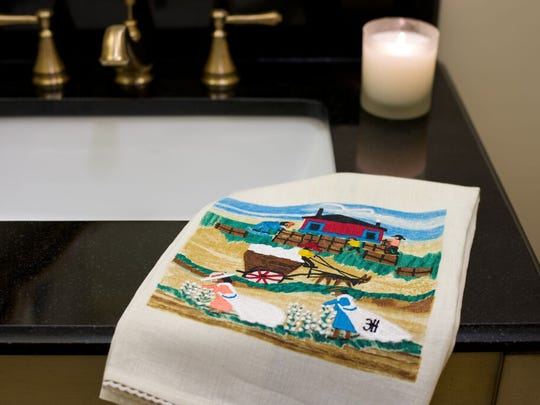 Doug Gitter reproduces Clementine Henry's works on various mediums, including towels.
