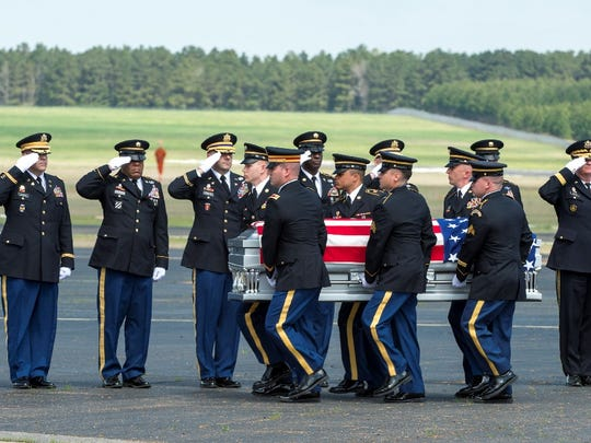 Maj. Gen. Glenn H. Curtis, adjutant general of the Louisiana National Guard, and other senior leaders honor fallen Chief Warrant Officer 4 David Strother during a deplaning ceremony in March at Esler Air Field in Pineville.