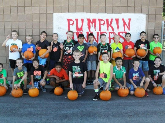 Fifth grade VVES students hold their winning pumpkins
